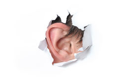 Ear in a hole of paper Royalty Free Stock Images