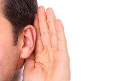 Ear listening secret. Isolated on white royalty free stock photo