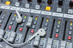 In ear. Monitors on a analog audio mixing console Stock Photo
