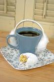 Ear muffs on coffee mug Royalty Free Stock Image