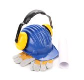 Ear muffs on hard hat and gloves. Isolated on a white background royalty free stock photos