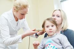 Ear, nose, throat examining. ENT doctor with a child and endoscope. otolaryngology. Ear, nose, throat. Female doctor or ENT specialist with a child patient stock images