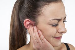 Ear pain. On white background Royalty Free Stock Photos