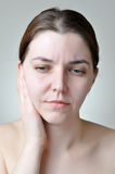 Ear pain. Young woman with painful facial expression Stock Photos