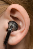 Ear phone. An ear with a communication equipment Stock Photography