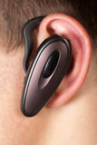 Ear phone. An ear with a wireless communication equipment Stock Images