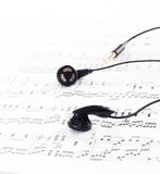 Ear phone on the top of a music Stock Photography