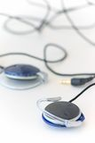 Ear-phones. A pair of recent ear-phones Royalty Free Stock Photo