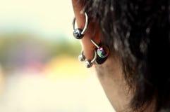 Ear with piercing Stock Photos