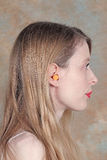 Ear plug noise. Woman wearing ear plug as noise cancellation Stock Photography
