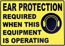 Ear Protection. A sign displaying safety requirements for ear protection Royalty Free Stock Photos