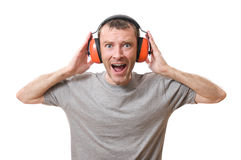 Ear protection. Shouting man with ear protection versus loud sound Royalty Free Stock Photo