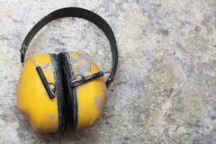 Ear protection factory noise muffs Yellow Royalty Free Stock Image