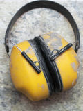 Ear protection factory noise muffs Yellow. Ear protection Yellow noise muffs toolwork royalty free stock photography