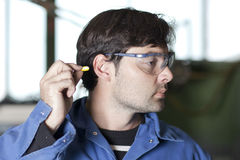 Ear protection at work stock photo
