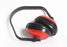 Ear protectors. Close-up picture of red ear protectors royalty free stock photography