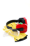 Ear protectors with gloves and goggles Royalty Free Stock Images