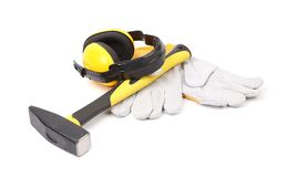 Ear protectors, hammer and gloves. Stock Image