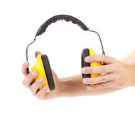 Ear protectors in human hand. Stock Images