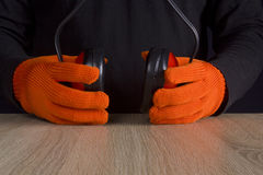 Ear protectors in human hand. Royalty Free Stock Image