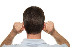 Ear Reflexology. Caucasian man seen from the back self massaging both of his ears with his hands at the same time with reflexology in front of a white background Stock Image