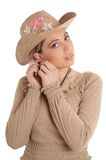 Ear-ring. Pretty woman in straw hat Royalty Free Stock Photography