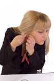 Ear-rings. Young blondie woman putting ear rings on her ears Stock Photo