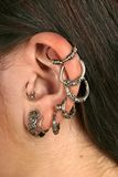 Ear-rings -close up. Girl, young woman with ear-rings -close up Royalty Free Stock Image