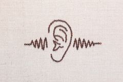 Ear and a sound wave made from coffee beans,aligned in the center stock photos