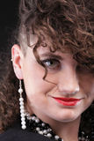 Ear super piercing woman curly girl Stock Photos