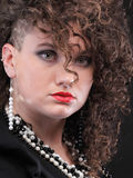 Ear super piercing woman curly girl Stock Photography