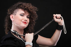 Ear super piercing woman curly girl Stock Image