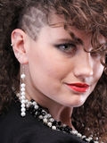 Ear super piercing woman curly girl Royalty Free Stock Image