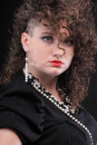 Ear super piercing woman curly girl Royalty Free Stock Images