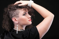Ear super piercing woman curly girl haircut Stock Image