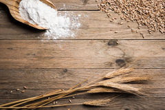 Ear wheat. Ear grains, flour and wholegrains on wood table Stock Photography
