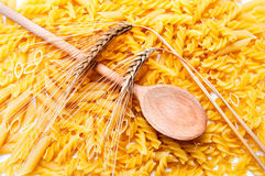 Ear of wheat, pasta and wooden spoon Royalty Free Stock Photo