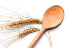 Ear of wheat and wooden spoon Royalty Free Stock Images