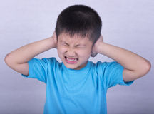 Earache. Children suffering from earache from listening to loud noise and the stress and depression Stock Photos