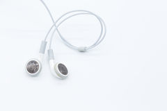 Earbuds blancs Photo stock