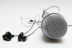 Earbuds e microfone Fotografia de Stock
