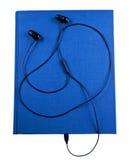 Earbuds mit Notizbuch Lizenzfreies Stockfoto