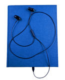 Earbuds with notebook. Black earbuds connected to blue notebook isolated Royalty Free Stock Photo