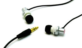 Earbuds and phono plug Royalty Free Stock Images