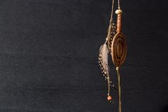 Earing feather. A earing whit feahter on black back ground Royalty Free Stock Images