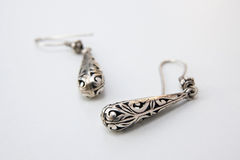 Earings. A pair of earings silver isolated Royalty Free Stock Photos