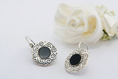 Earings. A pair of silver earings with rose Stock Photography