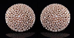 Earings del diamante con la riflessione immagini stock