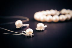 Earings and necklace Royalty Free Stock Photography