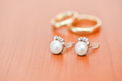 Earings and rings. Close-up details of wedding earings Stock Image